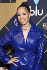 FILE - In this Feb. 3, 2018 file photo, Cardi B arrives at the Maxim Super Bowl Party in Minneapolis. The 25-year-old rapper welcomed Kulture Kiari Cephus during a post on Instagram Wednesday, July 11. The girl was born Tuesday. (Photo by Omar Vega/Invision/AP, File)