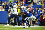 Seattle Seahawks wide receiver Dee Eskridge (1) is tackled by Indianapolis Colts outside linebacker Darius Leonard (53) in the first half of an NFL football game in Indianapolis, Sunday, Sept. 12, 2021. (AP Photo/Charlie Neibergall)