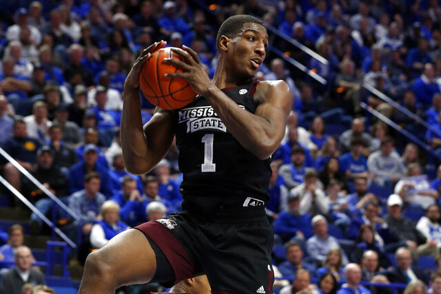 Mississippi State's Reggie Perry pulls down a rebound during the second half of the team's NCAA college basketball game against Kentucky in Lexington, Ky., Tuesday, Feb. 4, 2020. Kentucky won 80-72. (AP Photo/James Crisp)