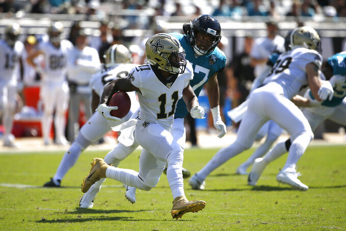 New Orleans Saints wide receiver Deonte Harris (11) runs past Jacksonville Jaguars linebacker D.J. Alexander after a reception during the first half of an NFL football game, Sunday, Oct. 13, 2019, in Jacksonville, Fla. (AP Photo/Stephen B. Morton)