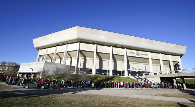 "FILE - In this Dec. 10, 2015, file photo, Iowa State students stand in line outside Hilton Coliseum before an NCAA college basketball game between Iowa State and Iowa, in Ames, Iowa. Iowa State President Wendy Wintersteen has transferred oversight of the Iowa State Center, a series of buildings near Hilton Coliseum and Jack Trice Stadium, to the athletic department. It has also tabbed athletic director Jamie Pollard to be the head of a process to redesign the area as an ""arts, culture, and community district."" The school announced the plan on Tuesday, Sept. 17, 2019, saying that Pollard and Iowa State Research Park President Rick Sanders will lead a feasibility study to build a multi-use development district between Hilton and Jack Trice _ which is now largely just parking lots. (AP Photo/Charlie Neibergall, File)"