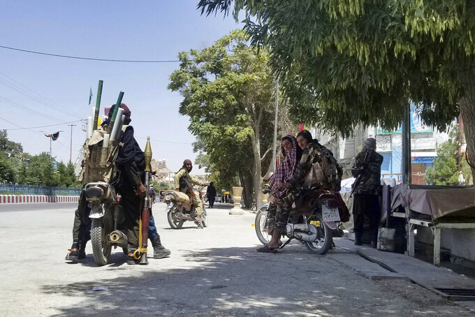 Taliban fighters patrol inside the city of Ghazni, southwest of Kabul, Afghanistan, Thursday, Aug. 12, 2021. The Taliban captured the provincial capital near Kabul on Thursday, the 10th the insurgents have taken over a weeklong blitz across Afghanistan as the U.S. and NATO prepare to withdraw entirely from the country after decades of war. (AP Photo/Gulabuddin Amiri)