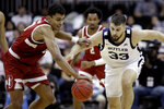 Stanford forward Oscar da Silva, left, and Butler forward Bryce Golden (33) chase a loose ball during the first half of an NCAA college basketball game, Tuesday, Nov. 26, 2019, in Kansas City, Mo. (AP Photo/Charlie Riedel)