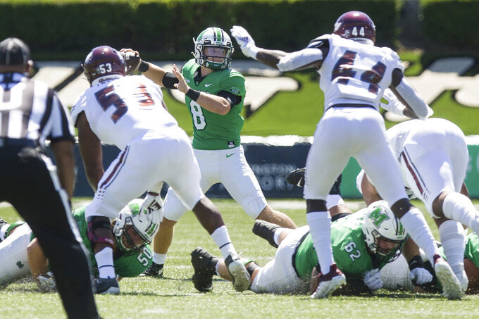 Marshall quarterback Grant Wells (8) throws against Eastern Kentucky during an NCAA college football game Saturday, Sept. 5, 2020, in Huntington, W.Va. (Sholten Singer/The Herald-Dispatch via AP)