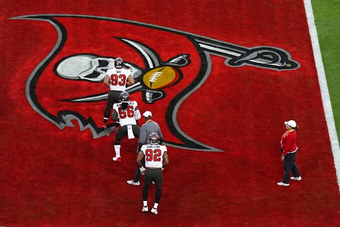 Tampa Bay Buccaneers warm up before the NFL Super Bowl 55 football game between the Kansas City Chiefs and Tampa Bay Buccaneers, Sunday, Feb. 7, 2021, in Tampa, Fla. (AP Photo/Charlie Riedel)