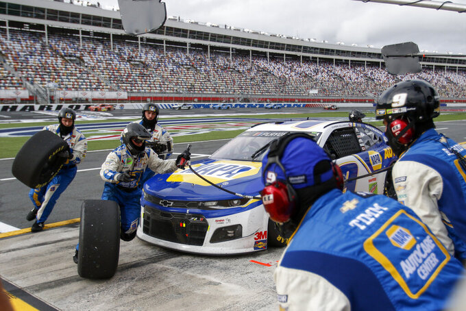 Chase Elliott's pit crew hurries through a pit stop in a NASCAR Cup Series auto race at Charlotte Motor Speedway in Concord, N.C., Sunday, Oct. 11, 2020. (AP Photo/Nell Redmond)