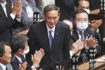 FILE - In this Sept. 16, 2020, file photo, Yoshihide Suga is applauded after being elected as Japan's new prime minister at parliament's lower house in Tokyo. Japan's new Prime Minister Suga heads to Vietnam and Indonesia on Sunday, Oct. 18, 2020, on his first overseas foray since taking over from his former boss Shinzo Abe last month. (AP Photo/Koji Sasahara, File)