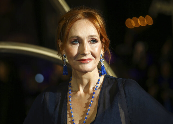 FILE - This Nov. 13, 2018 file photo shows author J.K. Rowling poses for photographers upon arrival at the premiere of the film 'Fantastic Beasts: The Crimes of Grindelwald', in London. Rowling has made a substantial donation for research into the treatment of multiple sclerosis at a center named after her late mother. The 15.3 million-pound ($18.8 million) donation announced Thursday, Sept. 12, 2019, will be used for new facilities at a research center based at the University of Edinburgh in Scotland. The author's mother suffered from the disease and died at the age of 45. (Photo by Joel C Ryan/Invision/AP, File)