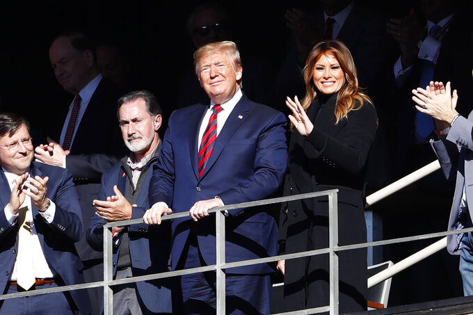President Donald Trump watches the first half of an NCAA football game between Alabama and LSU with his wife Melania Saturday, Nov. 9, 2019, in Tuscaloosa, Alb. (AP Photo/John Bazemore)