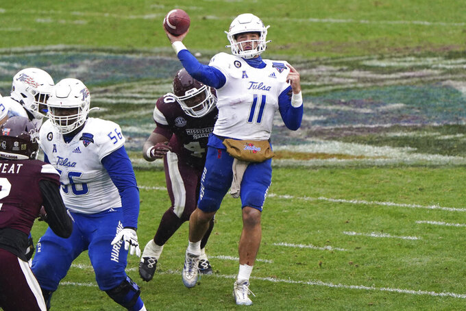 Tulsa quarterback Zach Smith (11) passes under pressure from Mississippi State linebacker Erroll Thompson (40) during the first half of the Armed Forces Bowl NCAA college football game Thursday, Dec. 31, 2020, in Fort Worth, Texas. (AP Photo/Jim Cowsert)