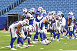 The Buffalo Bills stretch in pregame warmups during the ninth day of NFL football training camp at Bills Stadium in Orchard Park, N.Y., Thursday, Aug. 27, 2020. (James P. McCoy/Buffalo News via AP, Pool)