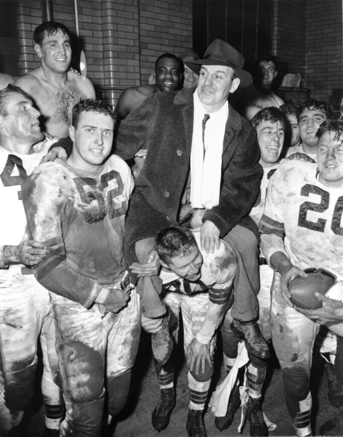 FILE - In this Dec. 11, 1949, file photo, The Cleveland Browns, All-America Football Conference champs, lift their coach, Paul Brown, onto their shoulders after defeating the San Francisco 49ers, 21-7, in Cleveland. Brown, the innovative coach and powerful team owner who brought dozens of improvements to the sport, has been voted pro football's greatest game changer.  (AP Photo/File)