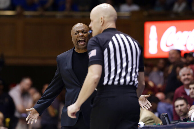 Florida State head coach Leonard Hamilton, left, yells at an official during the first half of an NCAA college basketball game against Duke in Durham, N.C., Monday, Feb. 10, 2020. (AP Photo/Gerry Broome)