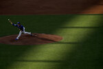 Kansas City Royals pitcher Brady Singer throws during an intrasquad baseball game at Kauffman Stadium on Wednesday, July 8, 2020 in Kansas City, Mo. (AP Photo/Charlie Riedel)