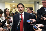 Sen. Marco Rubio, R-Fla., talks with reporters on Capitol Hill in Washington, Wednesday, July 10, 2019, after attending a briefing on election security. (AP Photo/Susan Walsh)