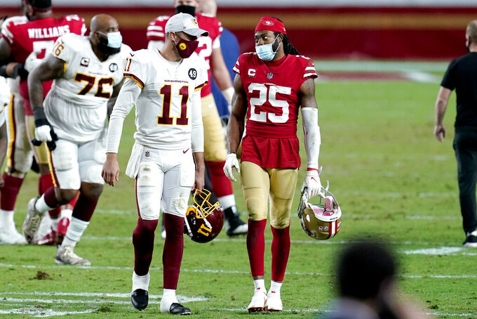 San Francisco 49ers wide receiver Brandon Aiyuk (11) and San Francisco 49ers cornerback Richard Sherman (25) speaks after an NFL football game, Sunday, Dec. 13, 2020, in Glendale, Ariz. Washington won 23-15. (AP Photo/Ross D. Franklin)