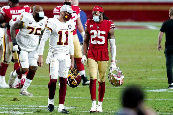 San Francisco 49ers wide receiver Brandon Aiyuk (11) and San Francisco 49ers cornerback Richard Sherman (25) speaks after an NFL football game, Sunday, Dec. 13, 2020, in Glendale, Ariz. Washington won 23-15. (AP Photo/Ross D. Franklin)