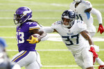 Minnesota Vikings running back Dalvin Cook (33) tries to break a tackle by Tennessee Titans safety Amani Hooker (37) during the first half of an NFL football game, Sunday, Sept. 27, 2020, in Minneapolis. (AP Photo/Bruce Kluckhohn)