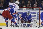 New York Rangers goaltender Alexandar Georgiev, right, stops a shot on goal by New York Islanders' Mathew Barzal during the second period of an NHL hockey game Tuesday, Jan. 21, 2020, in New York. (AP Photo/Frank Franklin II)