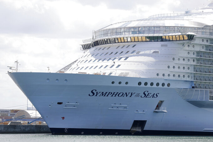 FILE - In this Wednesday, May 20, 2020, file photo, the Symphony of the Seas cruise ship is shown docked at PortMiami, in Miami. Florida is threatening to sue the federal government if it doesn't lift its pandemic ban on cruise lines using U.S. ports. Gov. Ron DeSantis and state Attorney General Ashley Moody said Friday, March 26, 2021, that the state is being harmed economically by the industry's U.S. shutdown. (AP Photo/Wilfredo Lee, File)