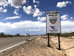 This Aug. 15, 2019 image shows the road to Spaceport America near Upham, New Mexico. Virgin Galactic CEO George Whitesides told a group of business leaders during a luncheon in Albuquerque, New Mexico, on Thursday, Dec. 5, 2019 that the spaceport is operationally ready and the company is aiming for commercial operations to start in 2020 after test flights are complete. (AP Photo/Susan Montoya Bryan)