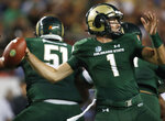 Colorado State quarterback K.J. Carta-Samuels looks to pass under pressure against Colorado in the first half of an NCAA college football game Friday, Aug. 31, 2018, in Denver. (AP Photo/David Zalubowski)