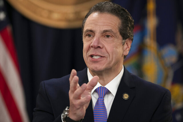 FILE - In this Jan. 24, 2019, file photo, New York Gov. Andrew Cuomo talks during a ceremony in New York. Cuomo announced Tuesday, March 10, 2020, he is sending the National Guard into the New York City suburb, New Rochelle, to help fight what is believed to be the nation's biggest cluster of coronavirus cases, one of the most dramatic actions yet to control the outbreak in the U.S. (AP Photo/Mark Lennihan, File)