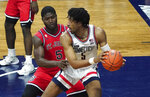 St. John's guard Dylan Addae-Wusu, front left, pressures Connecticut forward Isaiah Whaley, right, in the second half of an NCAA college basketball game in Storrs, Conn., Monday, Jan. 18, 2021.  (David Butler II/Pool Photo via AP)