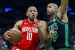 Houston Rockets' Eric Gordon (10) drives for the basket against Boston Celtics' Al Horford during the second half of an NBA basketball game in Boston, Sunday, March 3, 2019. (AP Photo/Michael Dwyer)