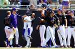 East Carolina's Turner Brown (8) is carried by Jake Kuchmaner (29) as he celebrates after scoring in the fifth inning against Campbell in an NCAA college baseball tournament regional game in Greenville, N.C., Monday, June 3, 2019. (Ethan Hyman/The News & Observer via AP)