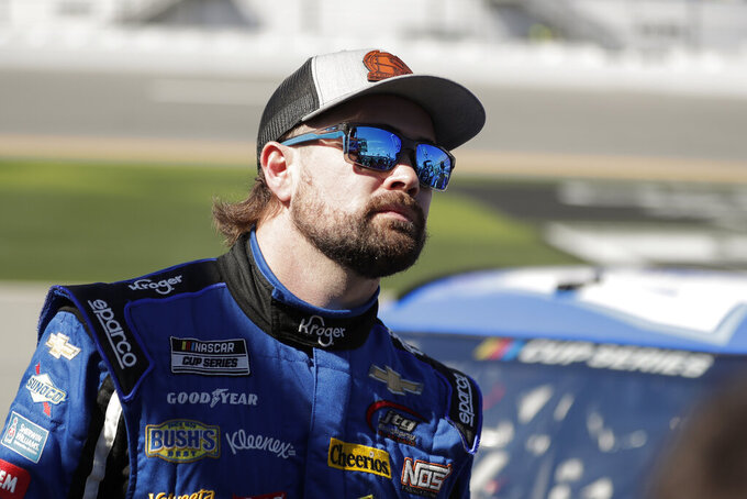 Ricky Stenhouse Jr. watches the leaderboard after his run during NASCAR auto race qualifying at Daytona International Speedway, Sunday, Feb. 9, 2020, in Daytona Beach, Fla. (AP Photo/John Raoux)