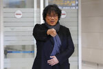 South Korean director Bong Joon-ho gestures upon his arrival at the Incheon International Airport in Incheon, South Korea, Sunday, Feb. 16, 2020. South Koreans are reveling in writer-director Bong's dark comic thriller,