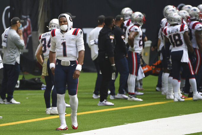 New England Patriots quarterback Cam Newton (1) wears a face mask while staring on the sideline during the first half of an NFL football game against the Houston Texans, Sunday, Nov. 22, 2020, in Houston. (AP Photo/Eric Christian Smith)