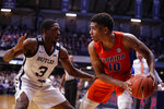 Florida guard Noah Locke (10) is defended by Butler guard Kamar Baldwin (3) in the second half of an NCAA college basketball game in Indianapolis, Saturday, Dec. 7, 2019. Butler defeated Florida 76-62. (AP Photo/Michael Conroy)