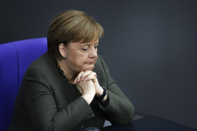 German Chancellor Angela Merkel listens to a debate on growing threats from far-right extremism at the German federal parliament, Bundestag, in the Reichstag building in Berlin, Germany, Thursday, March 5, 2020. (AP Photo/Markus Schreiber)