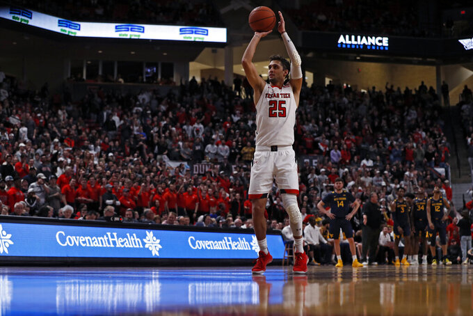 Texas Tech's Davide Moretti (25) shoots a free-throw after a technical foul during the second half of an NCAA college basketball game against West Virginia, Wednesday, Jan. 29, 2020, in Lubbock, Texas. (AP Photo/Brad Tollefson)