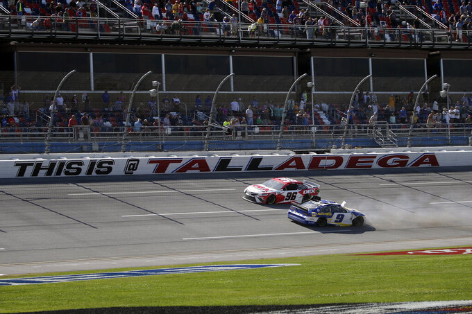 NASCAR Cup Series driver Chase Elliott (9) spins out as NASCAR driver Harrison Burton passes him during the Geico 500 NASCAR Sprint Cup auto race at Talladega Superspeedway Sunday, April 25, 2021 in Talladega, Ala. (AP Photo/Butch Dill)