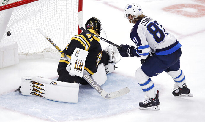 Winnipeg Jets left wing Kyle Connor (81) beats Boston Bruins goaltender Jaroslav Halak for the only goal during a shootout following an overtime period of an NHL hockey game in Boston, Tuesday, Jan. 29, 2019. Connor also scored two goals in the third period, as the Jets defeated the Bruins 4-3. (AP Photo/Charles Krupa)