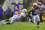 LSU running back Clyde Edwards-Helaire (22) breaks into the open past Northwestern State outside linebacker Landon King (32) in the first half of an NCAA college football game, Saturday, Sept. 14, 2019, in Baton Rouge, La. (AP Photo/Patrick Dennis)