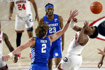 Kentucky Devin Askew, front left, knocks the ball away from Georgia's Sahvir Wheeler during an NCAA college basketball game Wednesday, Jan. 20, 2021, in Athens, Ga. (Joshua L. Jones/Athens Banner-Herald via AP)