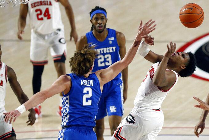 Kentucky Devin Askew, front left, knocks the ball away from Georgia's Sahvir Wheeler during an NCAA college basketball game Wednesday, Jan. 20, 2021, in Athens, Ga. (Joshua L. Jones/Athens Banner-Herald via AP)