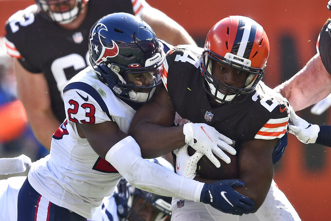 Cleveland Browns running back Nick Chubb (24) rushes against Houston Texans strong safety Eric Murray (23) during the second half of an NFL football game, Sunday, Sept. 19, 2021, in Cleveland. (AP Photo/David Richard)