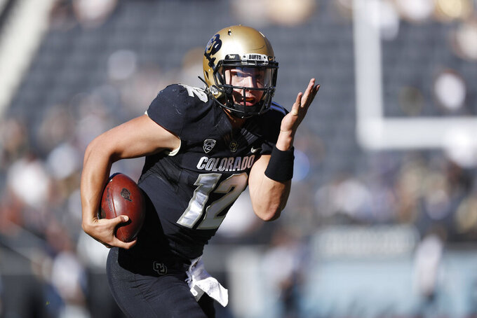 Colorado quarterback Steven Montez runs for a touchdown against Stanford in the first half of an NCAA college football game, Saturday, Nov. 9, 2019, in Boulder, Colo. (AP Photo/David Zalubowski)