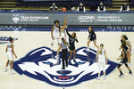 UConn tip-off against Butler to start an NCAA college basketball game Tuesday, Jan. 19, 2021, in Storrs, Conn. (David Butler II/Pool Photo via AP)