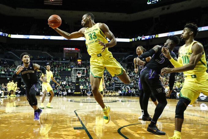 Oregon forward Francis Okoro (33) pulls down a rebound against Washington during the first half of an NCAA college basketball game Thursday, Jan. 24, 2019, in Eugene, Ore. (AP Photo/Thomas Boyd)