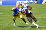 Western Michigan wide receiver Corey Crooms (4) runs away from Pittsburgh defensive back Erick Hallett (31) after making a catch during the first half of an NCAA college football game, Saturday, Sept. 18, 2021, in Pittsburgh. (AP Photo/Keith Srakocic)