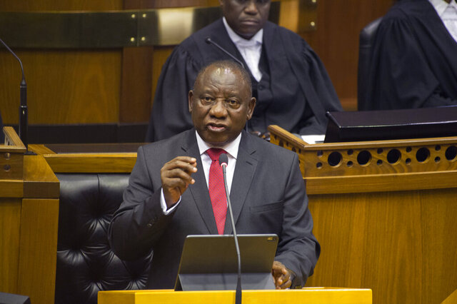 FILE — In this Thursday, June 20, 2019 file photo, South African President Cyril Ramaphosa delivers his State of the Nation Address in parliament in Cape Town, South Africa. Ramaphosa announced Thursday, Oct. 15, 2020 that his government will be extending relief measures to the country's poor who have been hurt by the economic downturn caused by COVID-19. (Rodger Bosch/Pool Photo via AP, FILE)
