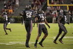 South Carolina linebacker Brad Johnson (19) and defensive lineman Kingsley Enagbare (52) celebrate a stop against Tennessee during the first half of an NCAA college football game Saturday, Sept. 26, 2020, in Columbia, S.C. (AP Photo/Sean Rayford)