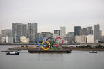 A barge carrying the Olympic Rings floats in the water Friday, Jan. 17, 2020, in the Odaiba district of Tokyo. (AP Photo/Jae C. Hong)