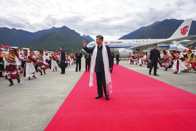 In this Wednesday, July 21, 2021 photo released on July 23, 2021 by China's Xinhua News Agency, Chinese President Xi Jinping waves as he arrives at the airport in Nyingchi in western China's Tibet Autonomous Region. Chinese leader Xi Jinping has made a rare visit to Tibet as authorities tighten controls over the Himalayan region's traditional Buddhist culture, accompanied by an accelerated drive for economic development. (Li Xueren/Xinhua via AP)